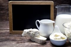 Milk and Camembert cheese with blackboard Royalty Free Stock Images