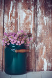 Milk can, and a bouquet Royalty Free Stock Photos
