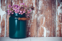 Milk can, and a bouquet Royalty Free Stock Images