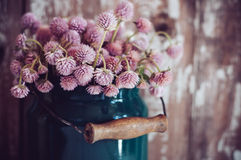 Milk can, and a bouquet Stock Photography