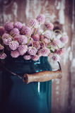 Milk can, and a bouquet Royalty Free Stock Image