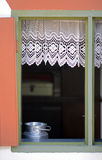 Milk can in the window with lace curtain Royalty Free Stock Photos