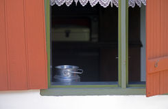 Milk can in the window with lace curtain Stock Photos