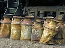 Milk cans. Old rusty milk cans evoke a sense of nostalgia royalty free stock photos