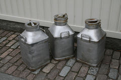 Milk cans. Three old vintage milk cans Royalty Free Stock Image