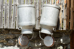 Free Milk Cans Hanging On A Wood Fence Country Scene, Austria, Tyrol Royalty Free Stock Photography - 88787267
