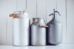 Milk cans  and a siphon Stock Photos