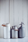 Milk cans  and a siphon Royalty Free Stock Images