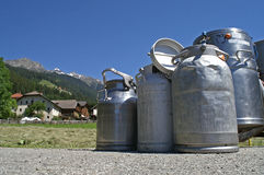 Milk cans are waiting for transport to the milkfactory. Royalty Free Stock Photography