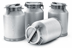 Milk cans. On white background Royalty Free Stock Photo