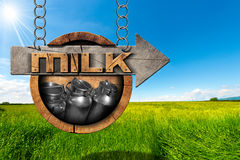 Milk Cans - Wooden Sign with Arrow in Countryside Royalty Free Stock Photos
