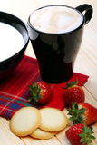 Milk and cappuccino with strawberries and waffles Royalty Free Stock Photography
