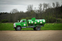 Milk car drawn with daisies Stock Photography