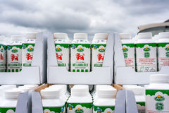 Milk cartons stacked outdoors. Royalty Free Stock Photography