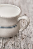 Milk in ceramic mug Royalty Free Stock Photography