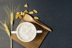 Milk with cereal. On dark background Stock Images