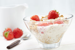 Milk with cereal and strawberries Stock Photos