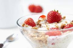 Milk with cereal and strawberries Stock Images