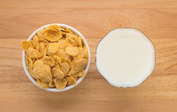 Milk and cereal. On wood background royalty free stock images