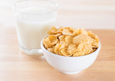 Milk and cereal. On wood table royalty free stock photography
