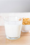 Milk and cereal. On wood table stock photography