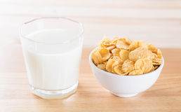Milk and cereal. On wood table royalty free stock image