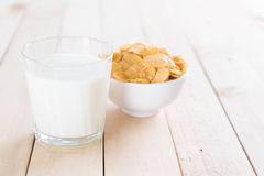 Milk and cereal. On wood table royalty free stock photo