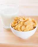 Milk and cereal. On wood table stock photo