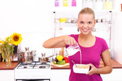 Milk into cereals Royalty Free Stock Photo