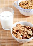 Milk and cereals. Two cups of cereals, glass of milk Royalty Free Stock Photo
