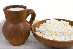 Milk and cheese in a clay pot Stock Photos