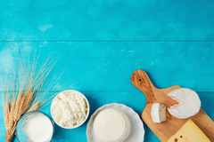 Milk and cheese, dairy products on wooden blue background. Jewish holiday Shavuot concept. Stock Photos