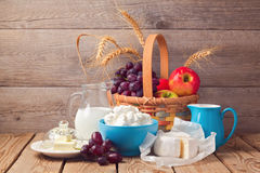 Milk, cheese and fruit basket over wooden background. Jewish holiday Shavuot celebration. Milk, cheese and fruit basket over wooden background. Jewish Shavuot Stock Photos
