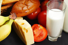 Milk and cheese with other food Royalty Free Stock Image