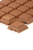 Milk Chocolate. A Milk Chocolate Bar against a white background Stock Photo