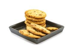 Milk chocolate almond cookies tower in black plate Stock Photo