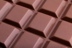 Milk chocolate bar macro very close view, from above royalty free stock photography