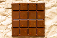 Milk chocolate bar with nuts Royalty Free Stock Photo