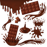 Milk chocolate bar and splashes Stock Photography