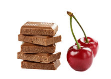 Milk chocolate bar with sweet cherry isolated Stock Photography