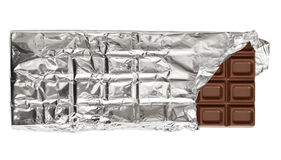 Milk chocolate bar in tinfoil Royalty Free Stock Image
