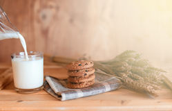 Milk with chocolate biscuits cereals Royalty Free Stock Image