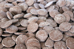 Milk Chocolate Button. Background of milk couverture chocolate buttons Stock Photos