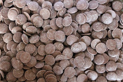 Milk Chocolate Buttons. Background of milk couverture chocolate buttons Stock Image