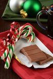 Milk chocolate and candy canes Stock Photography