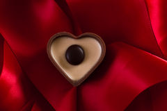 Milk chocolate with caramel cream in a heart shape Royalty Free Stock Image