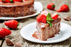 Milk chocolate cheesecake with milk chocolate icing and strawber Royalty Free Stock Photo