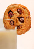 Milk and Chocolate Chip Cookie. Royalty Free Stock Photo