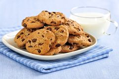 Milk and chocolate chip cookies royalty free stock photo