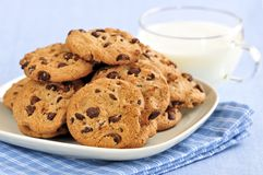 Milk and chocolate chip cookies Stock Photos